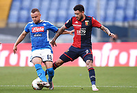 Stanislav Lobotka of SSC Napoli and Antonio Sanabria of Genoa compete for the ball during the Serie A football match between Genoa CFC and SSC Napoli stadio Marassi in Genova ( Italy ), July 08th, 2020. Play resumes behind closed doors following the outbreak of the coronavirus disease. <br /> Photo Matteo Gribaudi / Image / Insidefoto