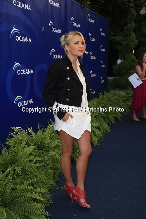LOS ANGELES - AUG 18:  Emily Osment at the Oceana's 6th Annual SeaChange Summer Party at the Beverly Hilton Hotel on August 18, 2013 in Beverly Hills, CA