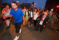 A horde of zombies converged on the newly-opened Zombie Burger + Drink Lab Friday evening in Des Moines' East Village.