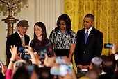 Manny Lindenbaum, lights the Menorah  during a Hanukkah reception in the East room of the White House, while his grand-daughter Lauren Lindenbaum (2L),  US First Lady Michelle Obama (2R) and  US President Barack Obama watch, in Washington, DC, December 9, 2015. In August of 1939, Manny and his brother escaped from Poland to England as refugees, and came to the United States in 1946. This is the second Hanukkah reception of the day for the President and the first Lady.<br /> Credit: Aude Guerrucci / Pool via CNP