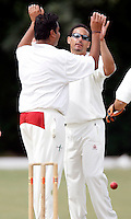 Paul Weekes (R) is congratulated by Chetan Patel (L) of Hornsey after he dismissed Mark Askew of North London during the Middlesex County League Division Three game between Hornsey and North London at Tivoli Road, Crouch End on Sat July 17, 2010