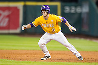 LSU Tigers shortstop Alex Bregman (8) takes his lead off of first base during the Houston College Classic against the Nebraska Cornhuskers on March 8, 2015 at Minute Maid Park in Houston, Texas. LSU defeated Nebraska 4-2. (Andrew Woolley/Four Seam Images)