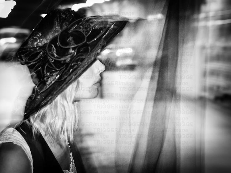 Profile direct flash shot of blonde model in a hat