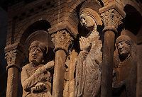 High relief of the annunciation, early 12th century, by the Master of the Tympanum, positioned 8m high on a pillar in the North transept of the Abbatiale Sainte-Foy de Conques or Abbey-church of Saint-Foy, Conques, Aveyron, Midi-Pyrenees, France, a Romanesque abbey church begun 1050 under abbot Odolric to house the remains of St Foy, a 4th century female martyr. Mary is surprised by the archangel Gabriel, on the left, whilst spinning wool, raising her hand in a gesture of acceptance. On the right, a servant takes her ball of wool. The church is on the pilgrimage route to Santiago da Compostela, and is listed as a historic monument and a UNESCO World Heritage Site. Picture by Manuel Cohen