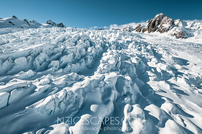 Huge crevasses and seracs of Explorer Glacier icefall in upper parts of Fox Glacier, Westland Tai Poutini National Park, West Coast, UNESCO World Heritage Area, New Zealand,, NZ