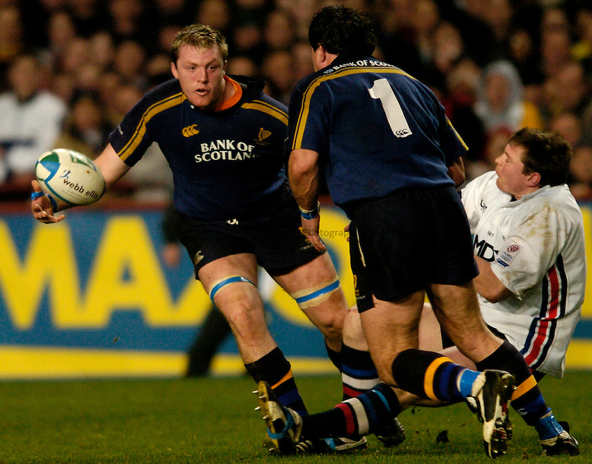 Photo: Richard Lane..Leinster Lions v Sale Sharks. Heinenken Cup. 09/01/2004..Eric Miller gets the ball away.