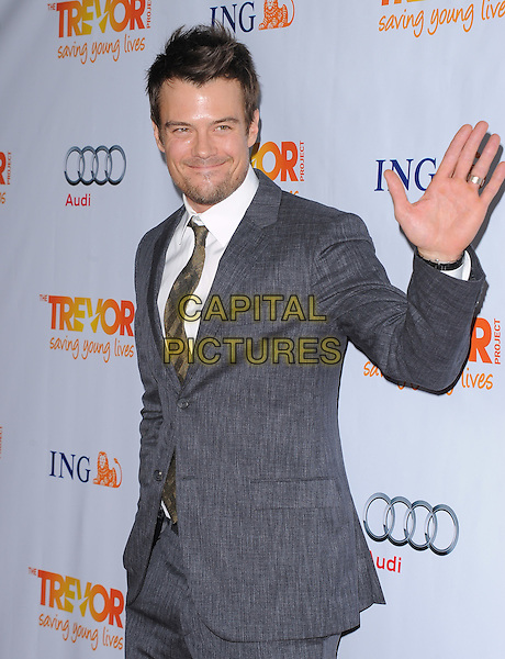 Josh Duhamel.Trevor Live at The Hollywood Palladium in Hollywood, California, USA..December 4th, 2011  .half length suit hand palm waving side grey gray shirt white facial hair  .CAP/RKE/DVS.©DVS/RockinExposures/Capital Pictures.
