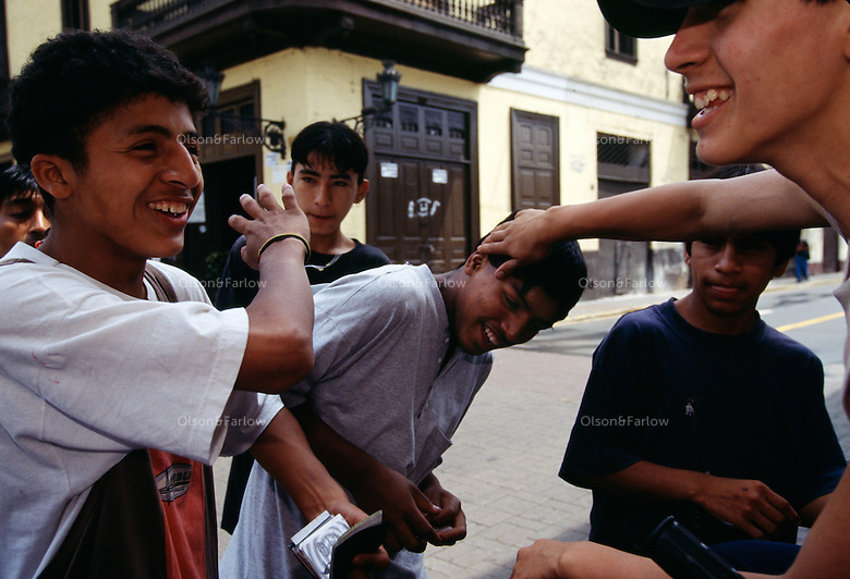 Boys hangout in front of Iglesia San Francisco which dates to 1687--famous for its catacombs located in Lima, Peru.