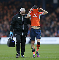 Dan Potts of Luton Town leaves the field with an injury during the Sky Bet League 2 match between Luton Town and Barnet at Kenilworth Road, Luton, England on 31 December 2016. Photo by David Horn.
