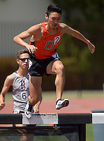 Apr 11, 2015; Los Angeles, CA, USA; Aaron Sugimoto of Occidental College races over the water jump in the steeplechase in a SCIAC multi dual meet at Occidental College. Sugimoto placed fourth in 9:52.68. Photo by Kirby Lee