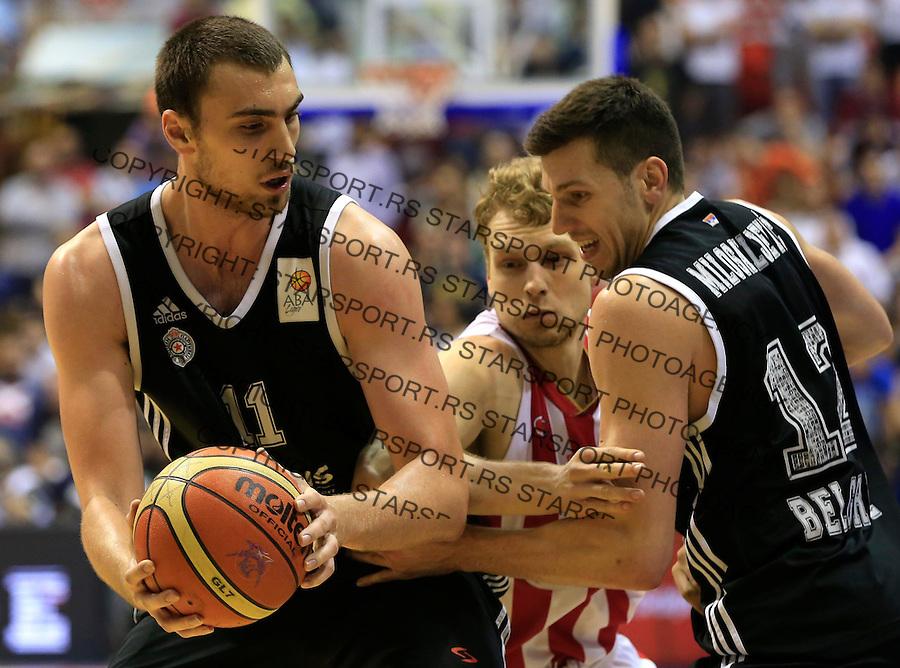 Kosarka Kosarkaska Liga Srbije season 2014-2015<br /> Crvena Zvezda v Partizan<br /> Nikola Milutinov (L) Jaka Blazic and Dragan Milosavljevic (R)<br /> Belgrade, 05.17.2015.<br /> foto: Srdjan Stevanovic/Starsportphoto &copy;