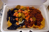 Tex-Mex nachos in a stryofoam tray. (© Richard B. Levine)