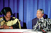 Washington, D.C. - June 25, 1990 -- Nelson Mandela, leader of the African National Congress (ANC), right, holds a press conference after meeting with United States President George H.W. Bush at the White House on Monday, June 25, 1990.  At left is his wife, Winnie Mandela..Credit: Ron Sachs / CNP