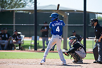 Kansas City Royals shortstop Maikel Garcia (4) at bat in front of catcher Evan Skoug (27) during an Instructional League game against the Chicago White Sox at Camelback Ranch on September 25, 2018 in Glendale, Arizona. (Zachary Lucy/Four Seam Images)