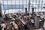 People in a waiting area of Toronto Pearson International airport, Canada 2014