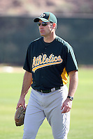 Joel Skinner #38, bench  coach of the Oakland Athletics, participates in spring training workouts at the Athletics complex on February 16, 2011  in Phoenix, Arizona. .Photo by:  Bill Mitchell/Four Seam Images.