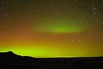 Northern lights (Aurora borealis) dancing across the sky over Badlands National Park, South Dakota