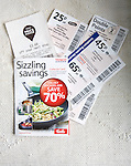 Tesco supermarket savings vouchers close up from above, UK