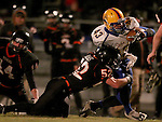 HOWARD, SD - NOVEMBER 8:  Lyle LaFramboise #43 from Alcester Hudson is brought down by Kaleb Haas #52 from Howard in the first half of their Class 9A Semifinal game Saturday night in Howard. (Photo by Dave Eggen/Inertia)