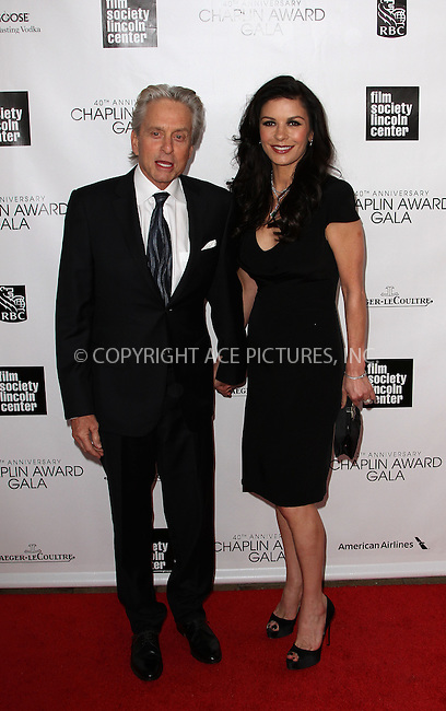 WWW.ACEPIXS.COM....April 22 2013, New York City....Actors Michael Douglas (L) and Catherine Zeta Jones arriving at the 40th Anniversary Chaplin Award Gala at Avery Fisher Hall at the Lincoln Center on April 22, 2013 in New York City.....By Line: Zelig Shaul/ACE Pictures......ACE Pictures, Inc...tel: 646 769 0430..Email: info@acepixs.com..www.acepixs.com