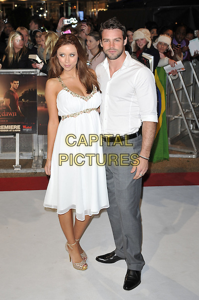 Una Healy of The Saturdays & Ben Foden.'The Twilight Saga: Breaking Dawn - Part 1' UK film premiere at Westfield Stratford City, London, England..16th November 2011.full length white dress shirt grey gray trousers pregnant couple stubble beard facial hair gold trim.CAP/MAR.© Martin Harris/Capital Pictures.