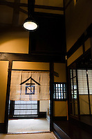"The entrance of the Tsukinokatsura sake brewery, Fushimi, Kyoto, Japan, October 10, 2015. Tsukinokatsura Sake Brewery was founded in 1675 and has been run by 14 generations of the Masuda family. Based in the famous sake brewing region of Fushimi, Kyoto, it has a claim to be the first sake brewery ever to produce ""nigori"" cloudy sake. It also brews and sells the oldest ""koshu"" matured sake in Japan."
