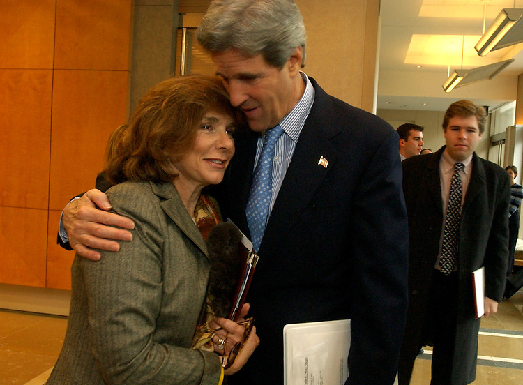 Sen. John Kerry, D-Mass., greets his wife Teresa Heinz Kerry, upon arrival at the Brookings Institution, before giving a speech.