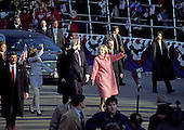 United States President Bill Clinton, center, accompanied by first lady Hillary Rodham Clinton, right, and Chelsea Clinton, left, wave to the crowds on Pennsylvania Avenue as they walk in the Inaugural Parade on January 20, 1997.<br /> Credit: Arnie Sachs / CNP