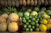 Amazon, Brazil. Variety of fruits on sale at a market stall: pineapple, melon, watermelon, banana, avocado; honey.