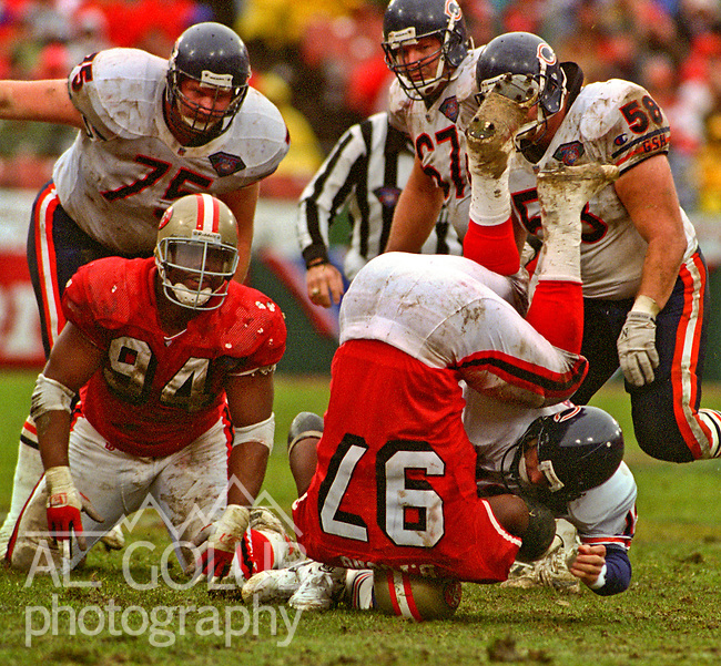San Francisco 49ers vs. Chicago Bears at Candlestick Park Saturday, January 7, 1995.  49ers beat Bears 44-15.  Chicago Bears quarterback Erik Kramer (12) is sacked by San Francisco 49ers defensive tackle Bryant Young (97).