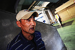 """""""Koji"""" Yamaguchi, a day laborer who has no fixed residential abode, after receiving a bed number at a shelter in the Kamagasaki district of Osaka, Japan."""