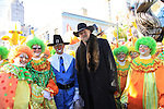 Country Singer Trace Atkins and clowns as they participate at the 86th Annual Macy's Thanksgiving Day Parade on November 22, 2012 in New York City, New York. (Photo by Sue Coflin/Max Photos)