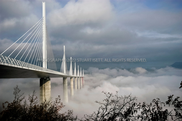 12/16/2004--Millau, France..The Millau Bridge is considered to be the world's tallest. One of the Millau bridge's pillars reaches more than eleven-hundred feet into the air, making it more than 50 feet taller than the Eiffel Tower. Designed by British architect, Norman Foster, the $523 million dollar bridge opens a new link between Paris and the Mediterranean....Photograph by Stuart Isett.©2010 Stuart Isett. All rights reserved