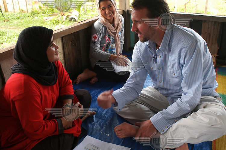 Actor Christopher Ecclestone visiting Aceh with the British Red Cross to raise awareness of the problems faced by people affected by the tsunami which struck this community a year earlier.