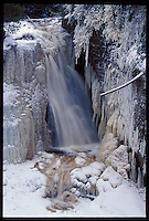 MINER'S FALLS IN PICTURED ROCKS NATIONAL LAKESHORE NEAR MUNISING MICHIGAN IN WINTER.