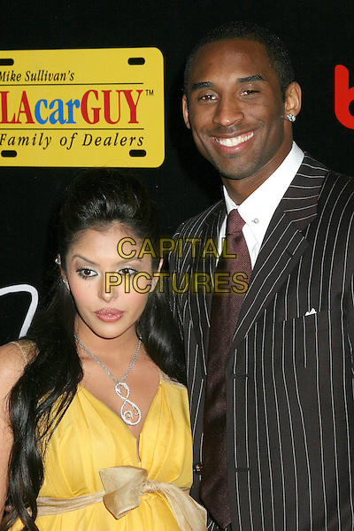 KOBE BRYANT & VANESSA (WIFE).3rd Annual Mirage Casino Night & Bodog Celebrity Poker Invitational, Santa Monica, California, USA..April 12th, 2006.Photo: Byron Purvis/AdMedia/Capital Pictures.Ref: BP/ADM.half length yellow husband married pinstripe black.www.capitalpictures.com.sales@capitalpictures.com.© Capital Pictures.