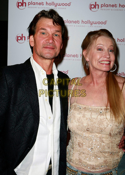 PATRICK SWAYZE & LISA NIEMI.Planet Hollywood Resort & Casino Grand Opening - Day 2 held at the Planet Hollywood Resort & Casino, Las Vegas, Nevada, USA..November 17th, 2007 .half length stubble facial hair beige married husband wife black jacket top .CAP/ADM/MJT.©MJT/AdMedia/Capital Pictures.