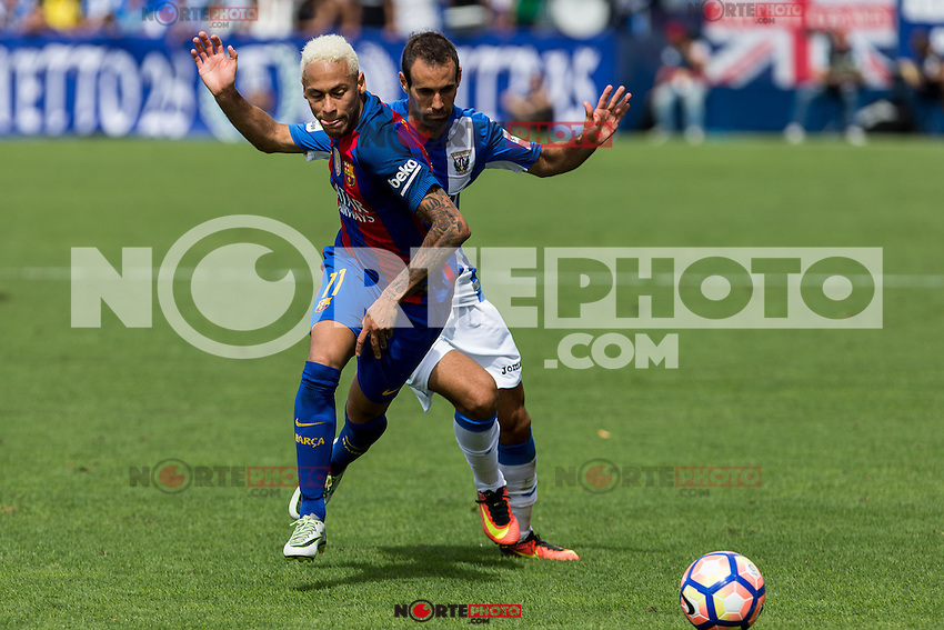 FC Barcelona's Neymar Santos Jr and Club Deportivo Leganes's Victor Diaz during the match of La Liga between Club Deportivo Leganes and Futbol Club Barcelona at Butarque Estadium in Leganes. September 17, 2016. (ALTERPHOTOS/Rodrigo Jimenez) /NORTEPHOTO