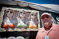 David Jelleman, Michigan, poses in front of a fabric sculpture during the 23rd Annual Downtown Naples Festival of the Arts, hosted by The von Liebig Art Association and Downtown Association, Naples, Florida, USA, March 26, 2011. Photo by Debi Pittman Wilkey