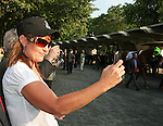 Former Governor of Alaska Sarah Palin takes a picture of  First Dude as he is saddled prior to running third in the 142nd  Belmont Stakes Day  at Belmont Park Racetrack, Elmont, New York.