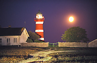 När Lighthouse at twilight with a near-full moon is situated on the east coast of Sweden's largest island, Gotland.