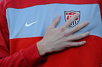 A USA player places his hand over his heart ad US Soccer emblem during the national anthems. USA vs Slovenia in the 2010 FIFA World Cup at Ellis Park in Johannesburg, South Africa on June 18th, 2010.