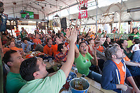 San Francisco, CA - Sunday, June 29, 2014: Mexico fans celebrate  at the SOMA StrEat Food Park watching the Netherlands vs. Mexico round of 16 World Cup match.