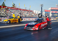 Feb 9, 2018; Pomona, CA, USA; NHRA funny car driver J.R. Todd (left) alongside Cruz Pedregon during qualifying for the Winternationals at Auto Club Raceway at Pomona. Mandatory Credit: Mark J. Rebilas-USA TODAY Sports
