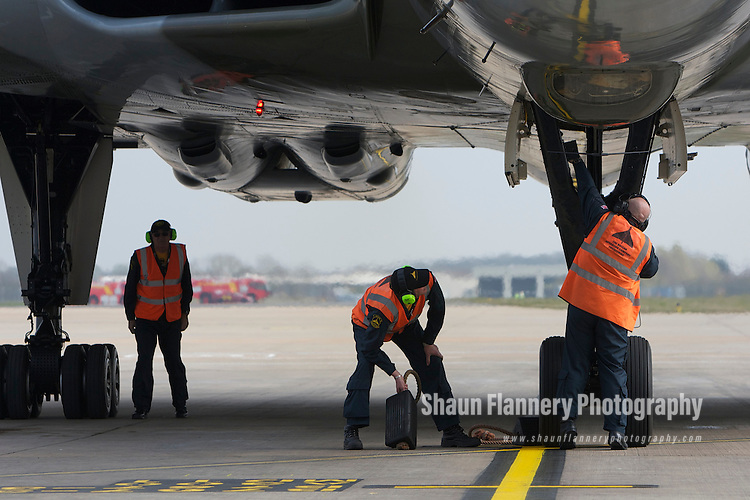 Pix: Shaun Flannery/shaunflanneryphotography.com...COPYRIGHT PICTURE>>SHAUN FLANNERY>01302-570814>>07778315553>>..29th March 2011..............The last flying Vulcan, XH558,  touches down at Robin Hood Airport Doncaster Sheffield. .Vulcan XH558 is to spend the summer based at the airfield where she once stood on Quick Reaction Alert during the Cold War..Operatives from the Vulcan Operating Company Engineering..