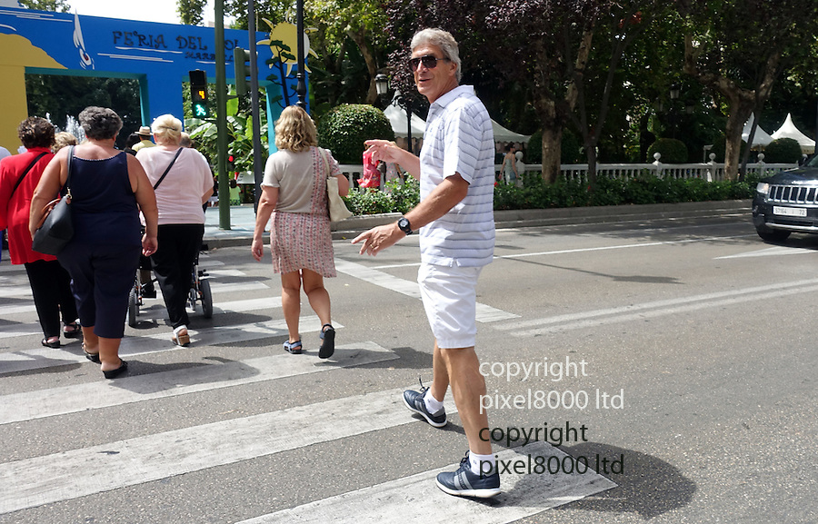 "Pic shows: Manuel Pellegrini seen out today in Marbella, Spain today with his wife, Carola Pucci, walking towards the beach <br /> as Manchester City the team that sacked him play out a crunch clash against West Ham in London.<br /> <br /> Asked if he would be watching the game today the relaxed looking Chilean gentleman <br /> shrugged and said ""I don't think so. I am taking a holiday. But good luck to them.""<br /> <br /> <br /> Just yesterday former Manchester City manager Manuel Pellegrini was appointed by the Chinese Super League side Hebei China Fortune.<br /> <br /> <br /> <br /> Pic by Gavin Rodgers/Pixel 8000 Ltd"