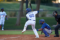 AZL Dodgers Mota Juan Zabala (60) at bat in front of catcher Reynaldo Pichardo (6) during an Arizona League game against the AZL Rangers at Camelback Ranch on June 18, 2019 in Glendale, Arizona. AZL Dodgers Mota defeated AZL Rangers 13-4. (Zachary Lucy/Four Seam Images)