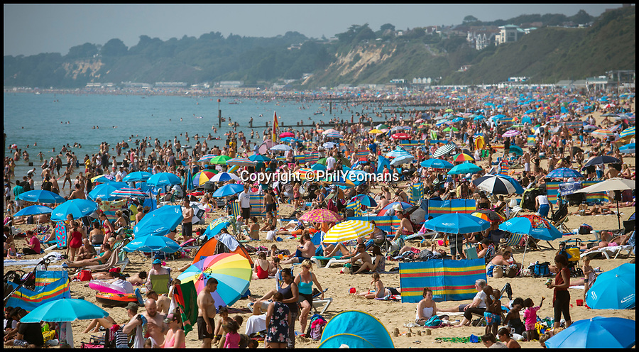 BNPS.co.uk (01202 558833)<br /> Pic: PhilYeomans/BNPS<br /> <br /> Bournemouth was packed on Monday as holidaymakers enjoyed the hottest August bank holiday on record as temperatures soared.<br /> <br /> What a difference two days make…<br /> <br /> Bournemouth beach is virtually deserted today as the hot weather evaporates and chilly drizzle returns to the south coast resort.