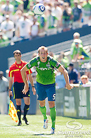Seattle Sounders FC defender Tyson Wahl (5) throws the ball upfield in a match against Columbus Crew at CenturyLink Field in Seattle, Washington. The Sounders defeated Columbus Crew, 6-2.