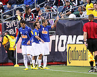 Cruzeiro forward Wellington Paulista celebrates with teamates Cruzeiro midfielder Roger and Cruzeiro forward Thiago Ribeiro after scoring his first goal.  Wellington Paulista went on to score all three of Cruzeiro's goals.  Brazil's Cruzeiro beat the New England Revolution, 3-0 in a friendly match at Gillette Stadium on June 13, 2010